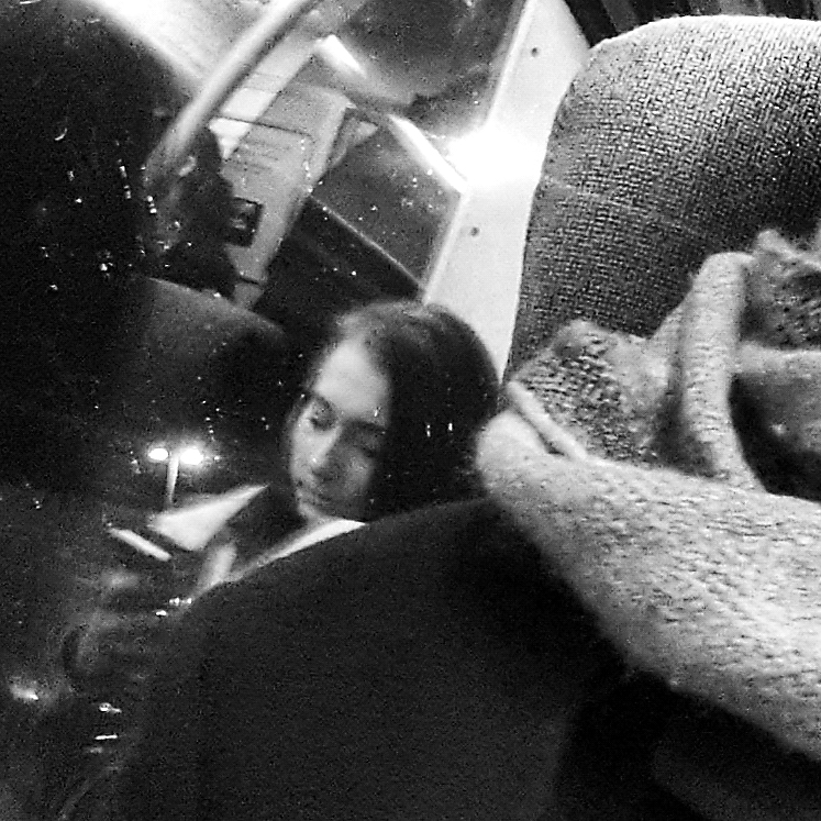 Commute 16 - Close up of scalf, woman in background