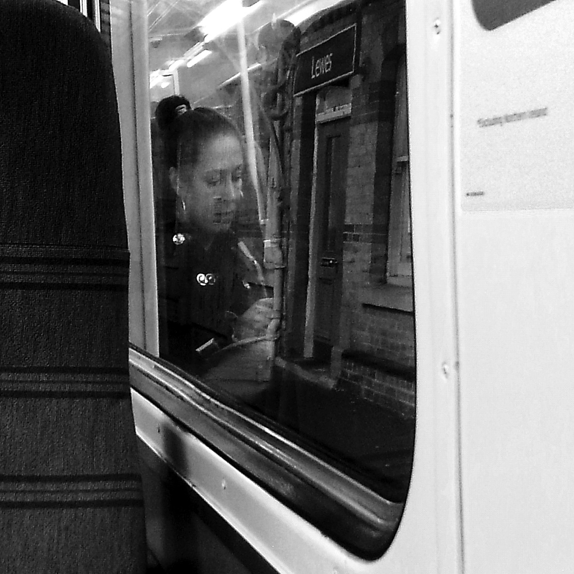 Commute 2 - Woman distorted in window